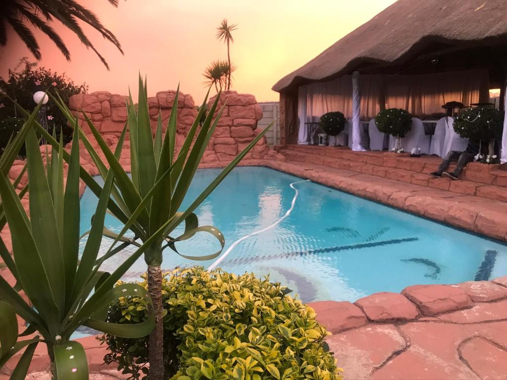 The swimming pool at or near African Executive Lodge