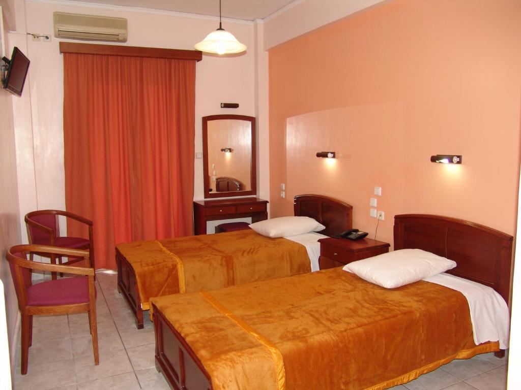 Een bed of bedden in een kamer bij Hotel Cosmos