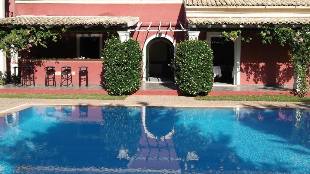 The swimming pool at or near Villa De Loulia