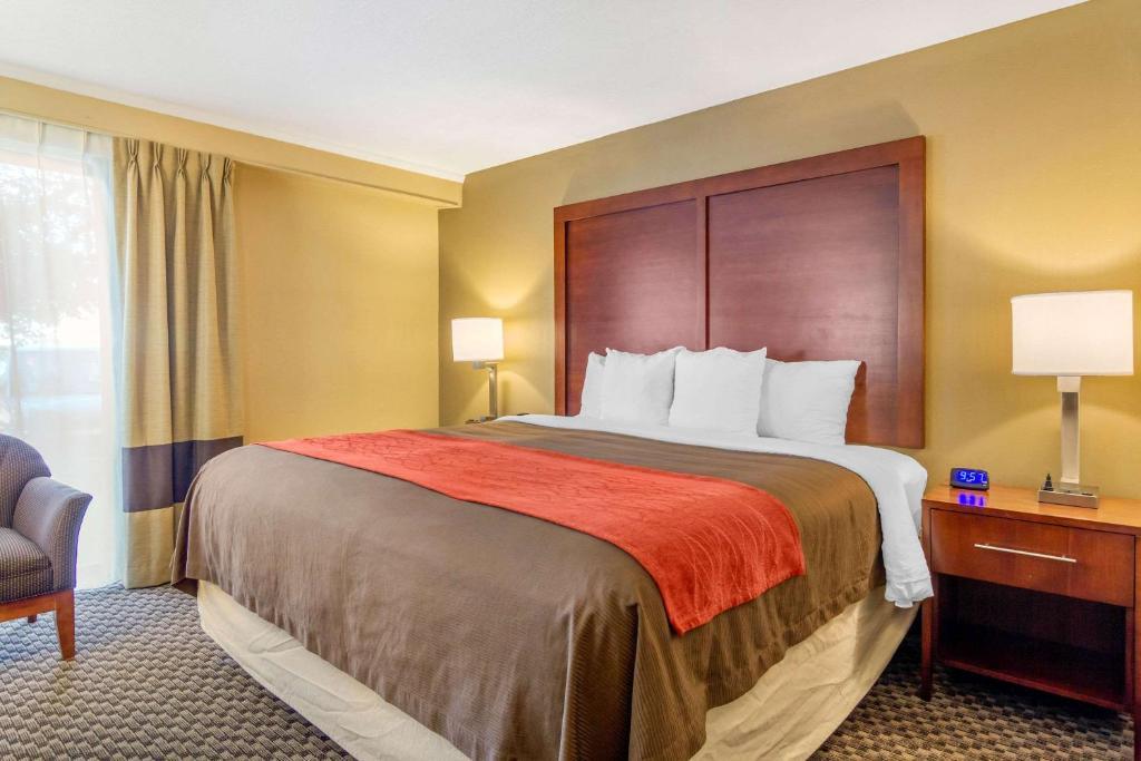 A bed or beds in a room at Comfort Inn Denver Central