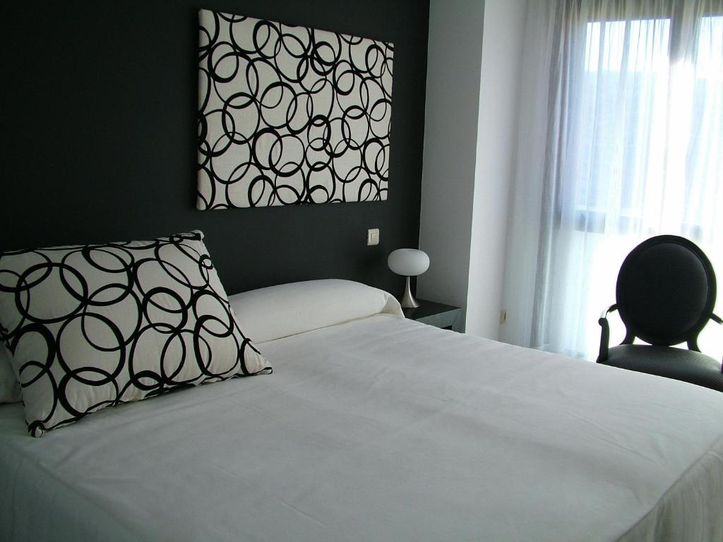 A bed or beds in a room at Vinacua