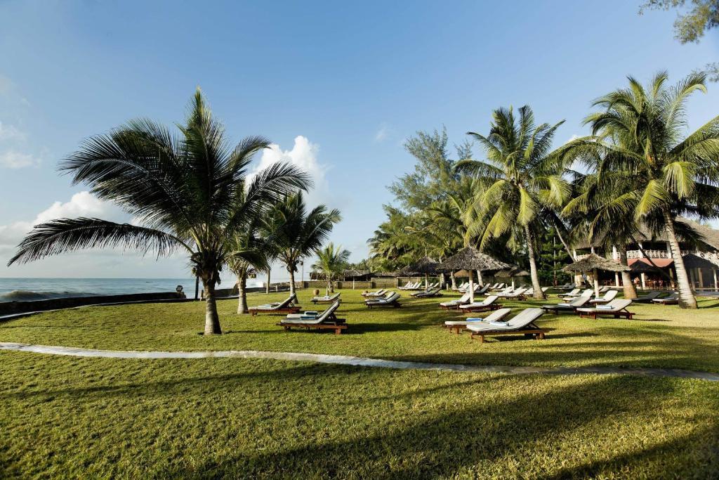 A garden outside Neptune Palm Beach Boutique Resort & Spa - All Inclusive