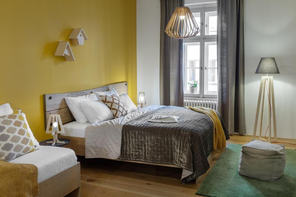 מיטה או מיטות בחדר ב-Four Trees