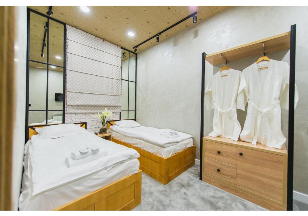 Кровать или кровати в номере My Hostel Almaty