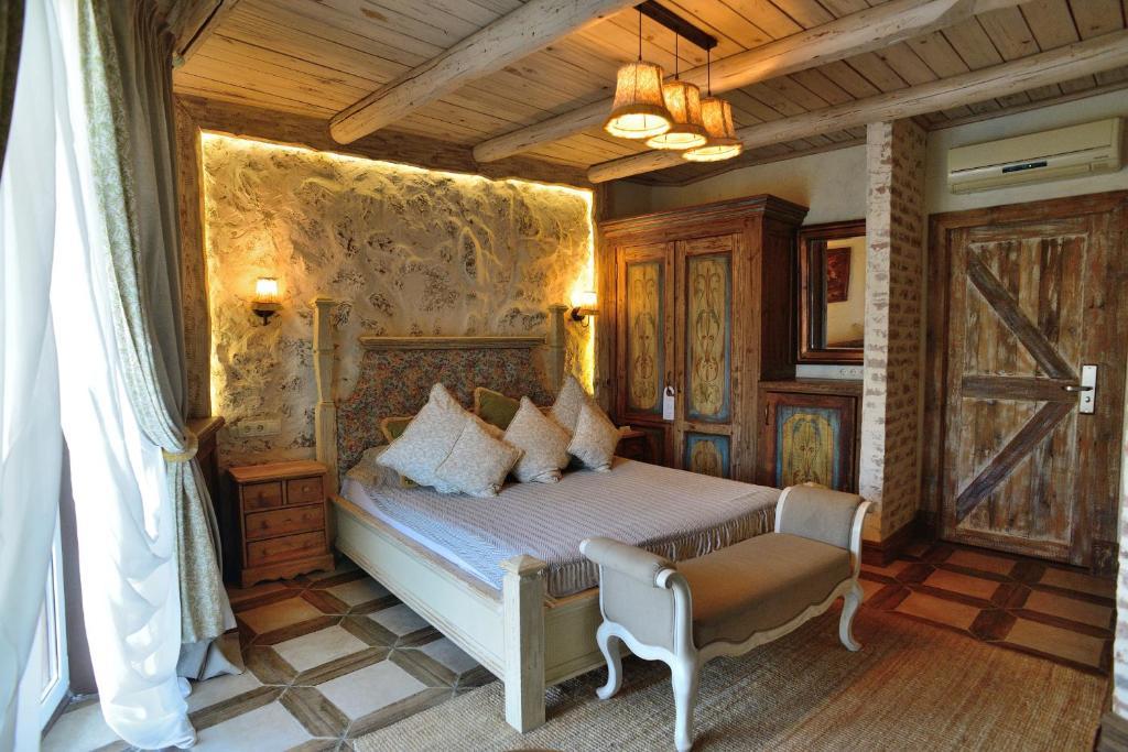Кровать или кровати в номере Rasslabonov Country Home