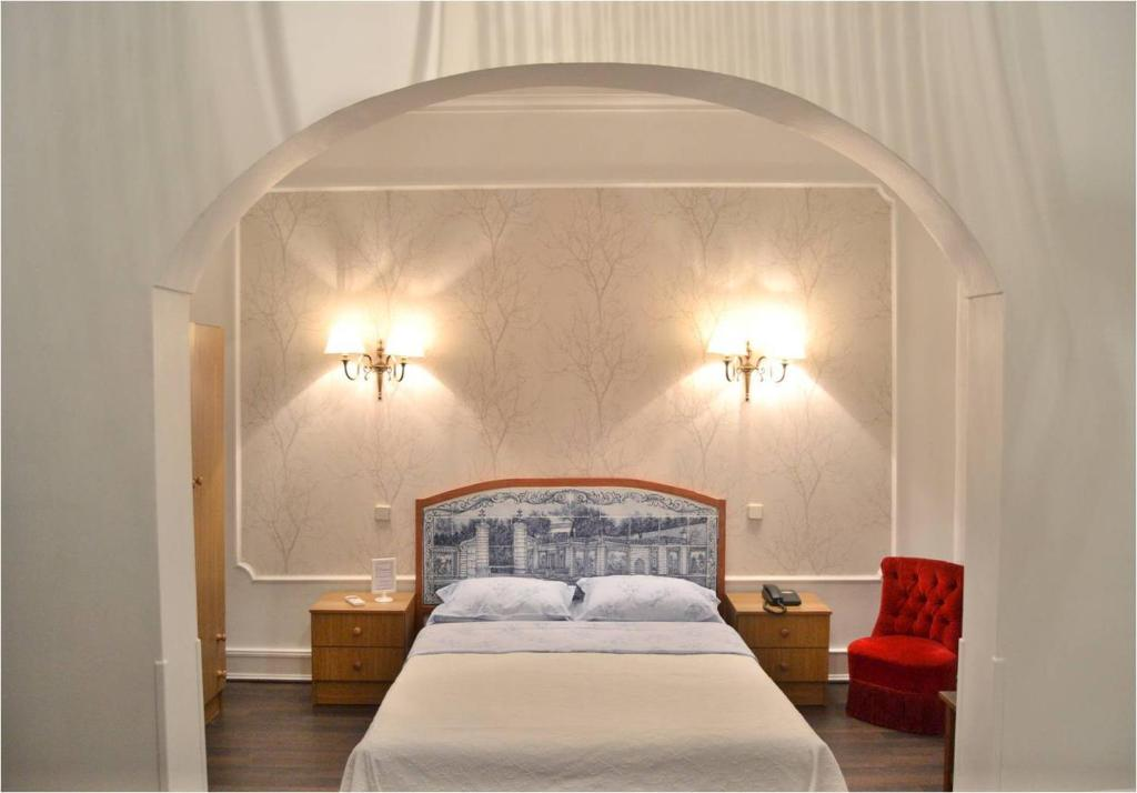 A bed or beds in a room at Londrina B&B Lisbon
