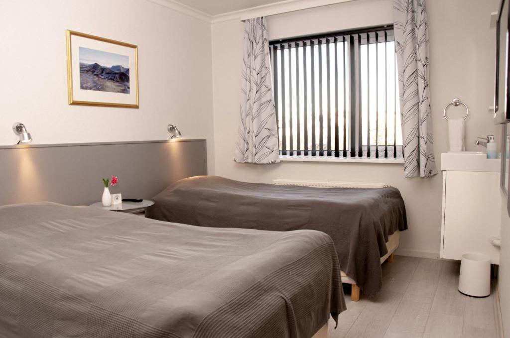 A bed or beds in a room at B&B Guesthouse - Bed and Breakfast Keflavik Centre