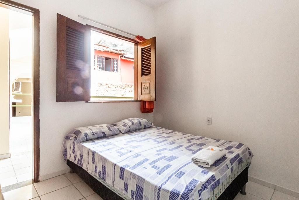 A bed or beds in a room at Pousada Ilha Encantada