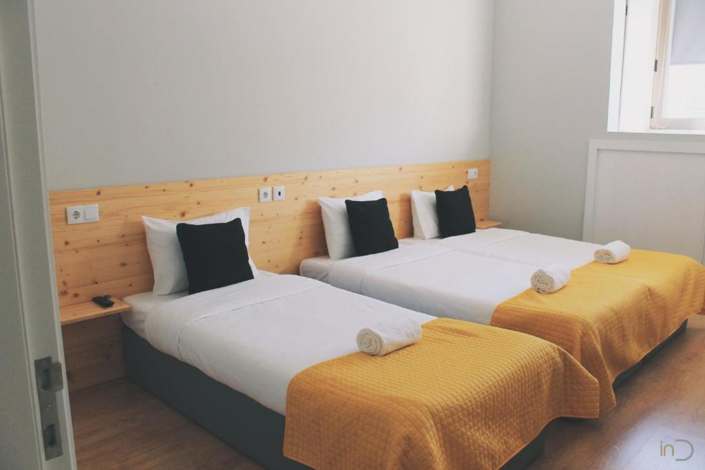 A bed or beds in a room at inDouro Hostel & Wine Bar
