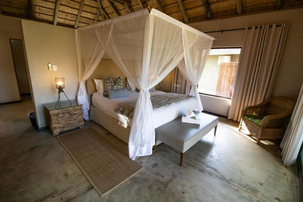 A bed or beds in a room at Xanatseni Private Camp