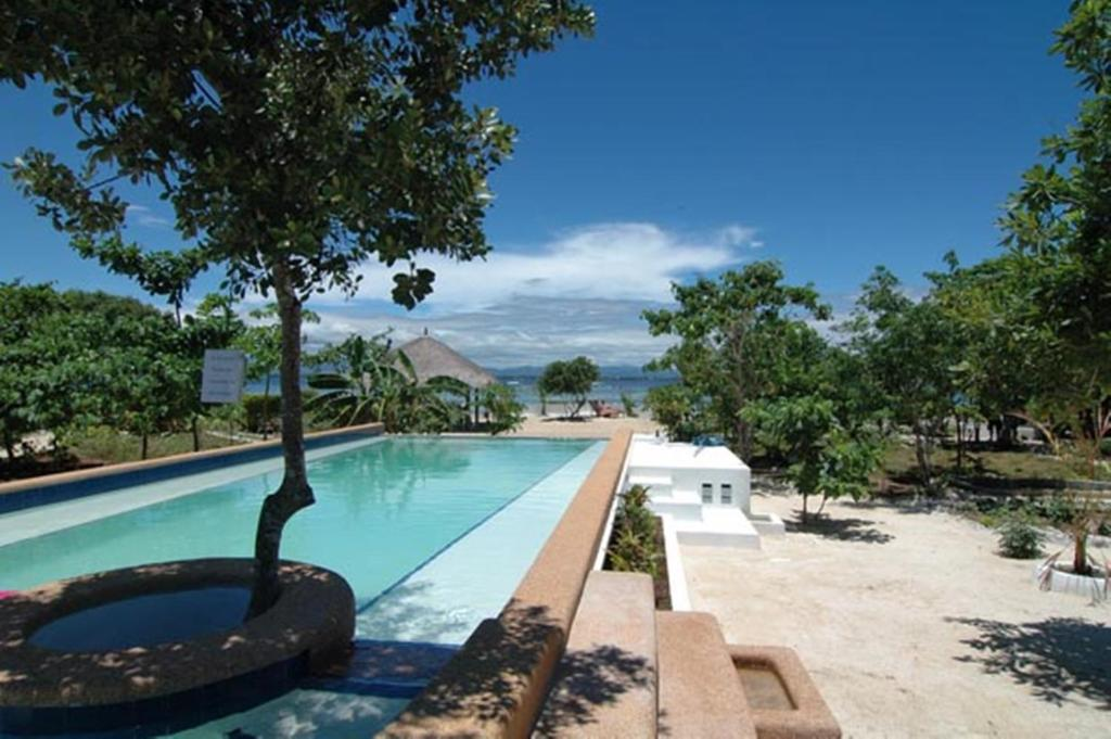 The swimming pool at or near Talima Beach Villas & Dive Resort