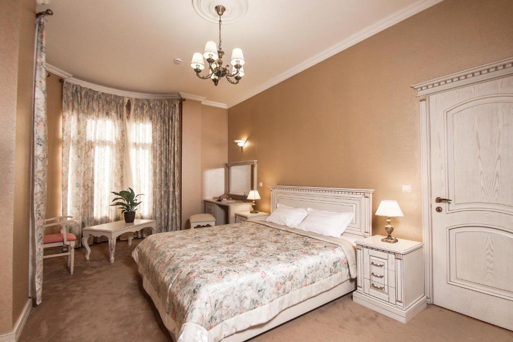 Кровать или кровати в номере Санаторий Золотой Колос