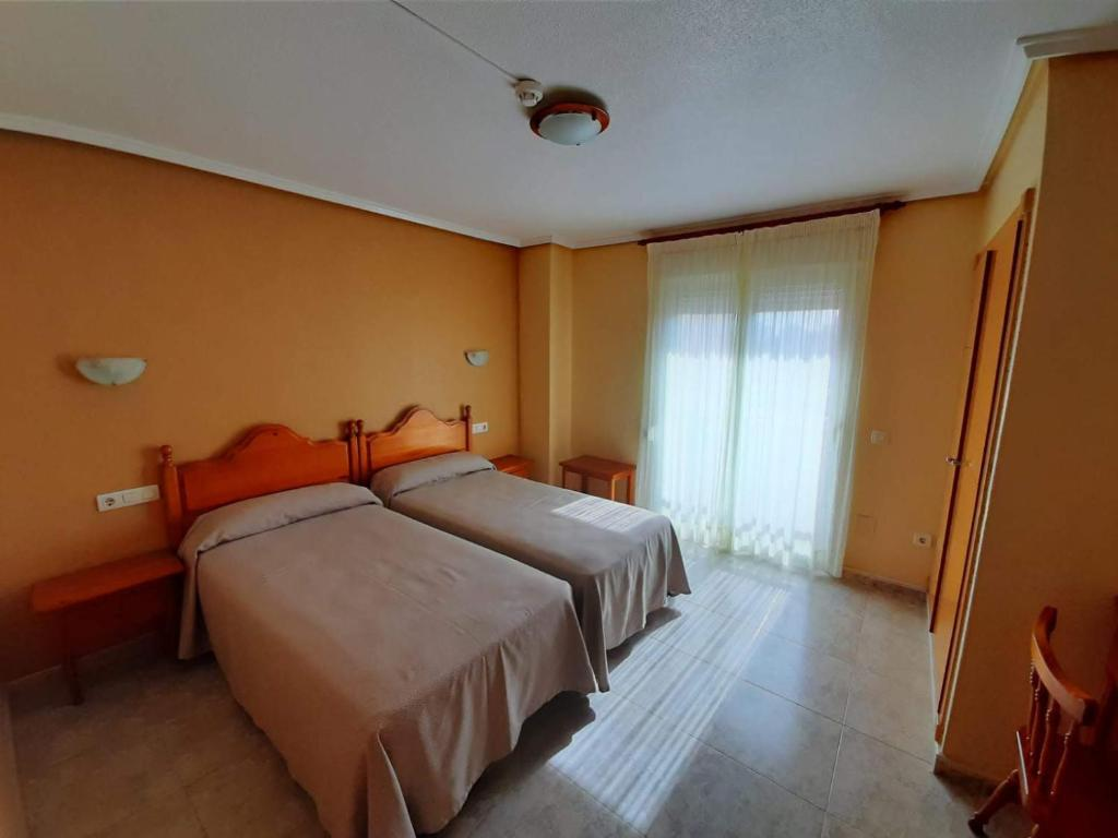 A bed or beds in a room at Hotel Cano