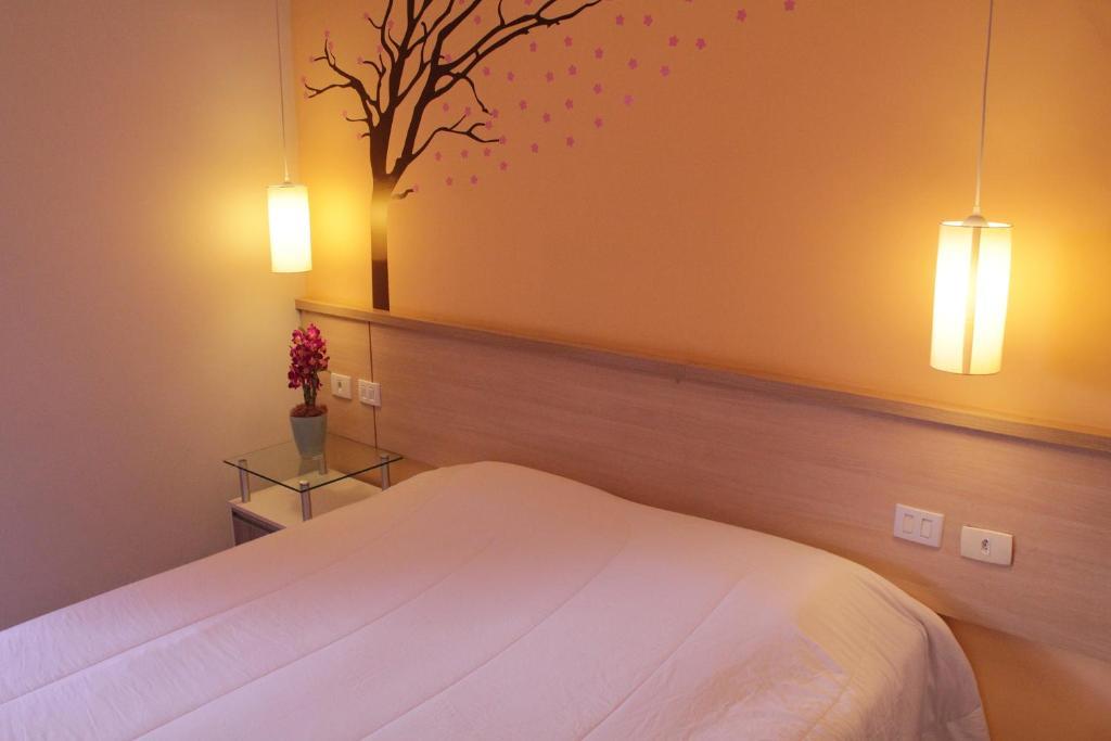 Cama ou camas em um quarto em São Paulo Lodge Business Hostel