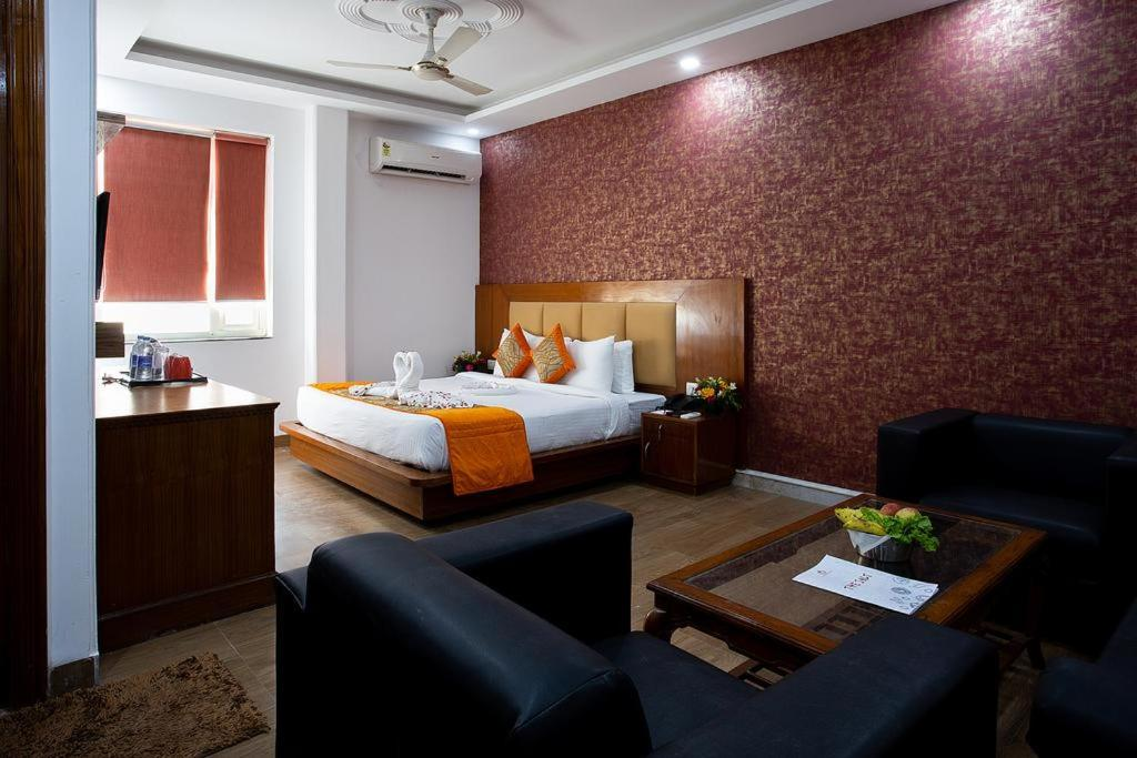 A bed or beds in a room at Airport Hotel Arrival Suites
