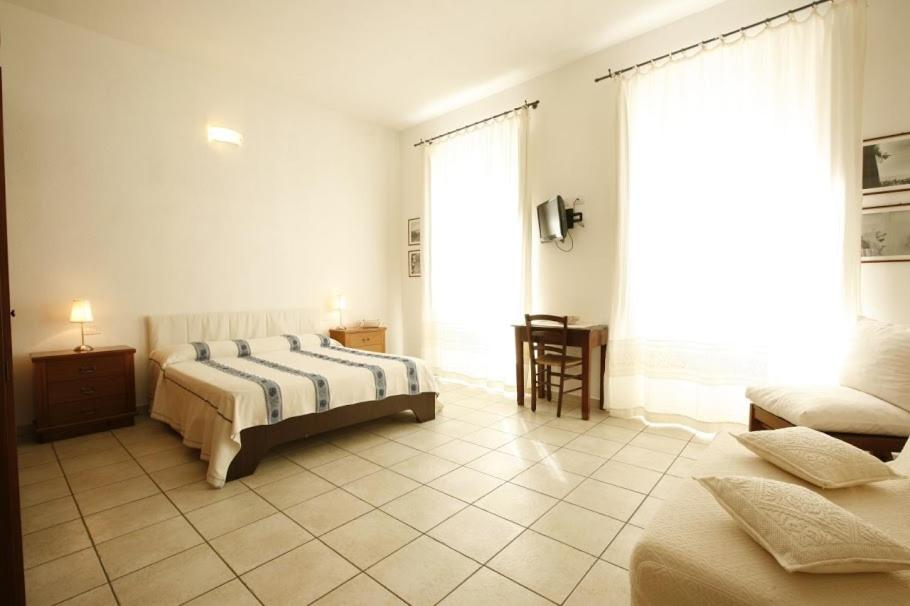 Letto o letti in una camera di L'Arco Cagliari
