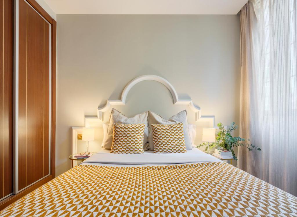 Кровать или кровати в номере Apartamentos Suites Oficentro