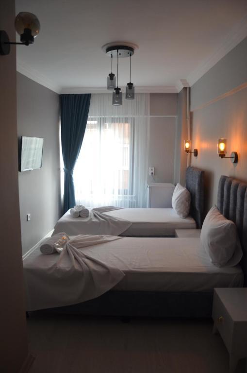 Кровать или кровати в номере Zion Home Butik Otel