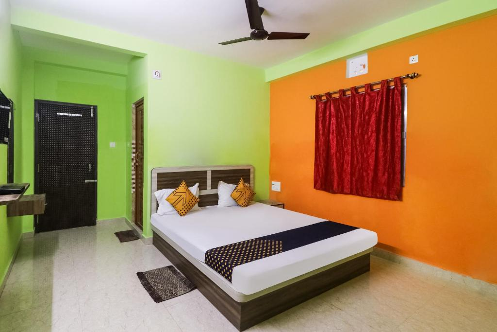 A bed or beds in a room at SPOT ON 70668 Sefali Dream Resort