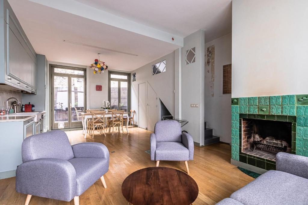 A seating area at Maison de ville avec Terrasse à Paris