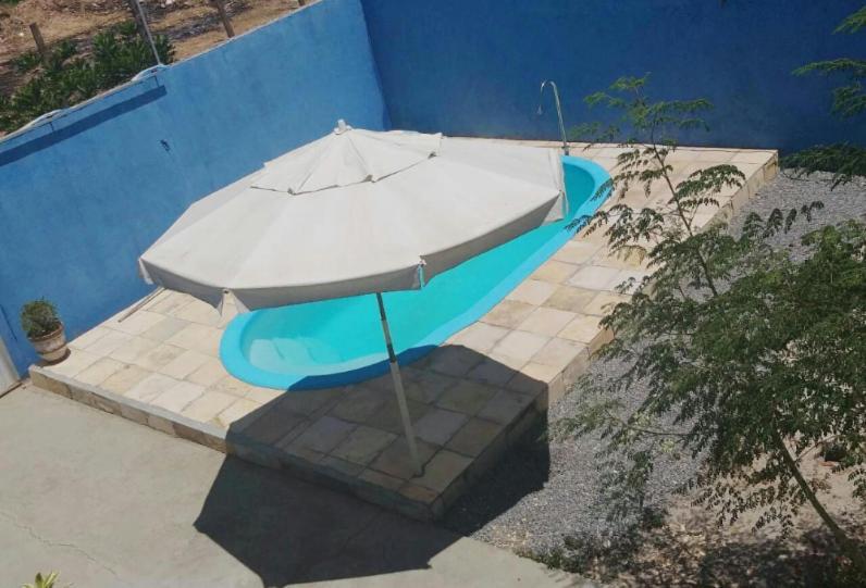 A view of the pool at Casa de praia com piscina or nearby