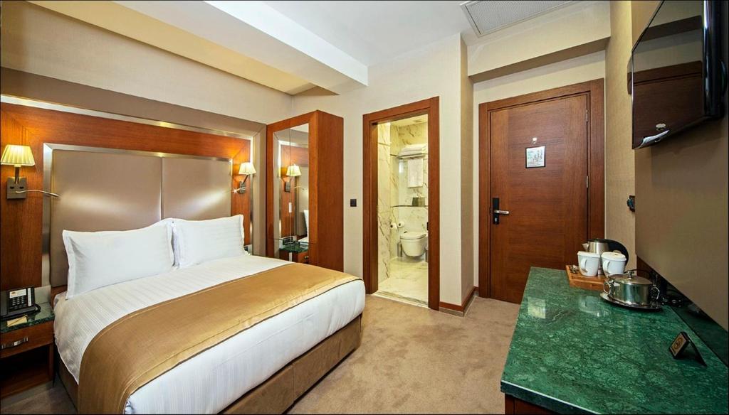 Кровать или кровати в номере Dosso Dossi Hotels Old City