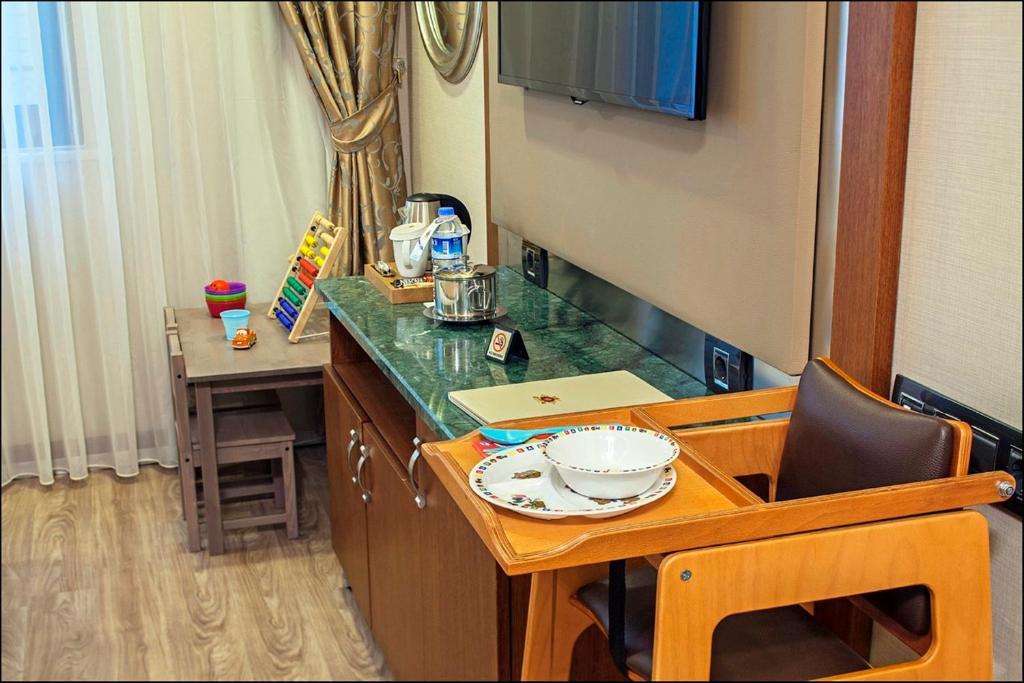 Телевизор и/или развлекательный центр в Dosso Dossi Hotels Old City