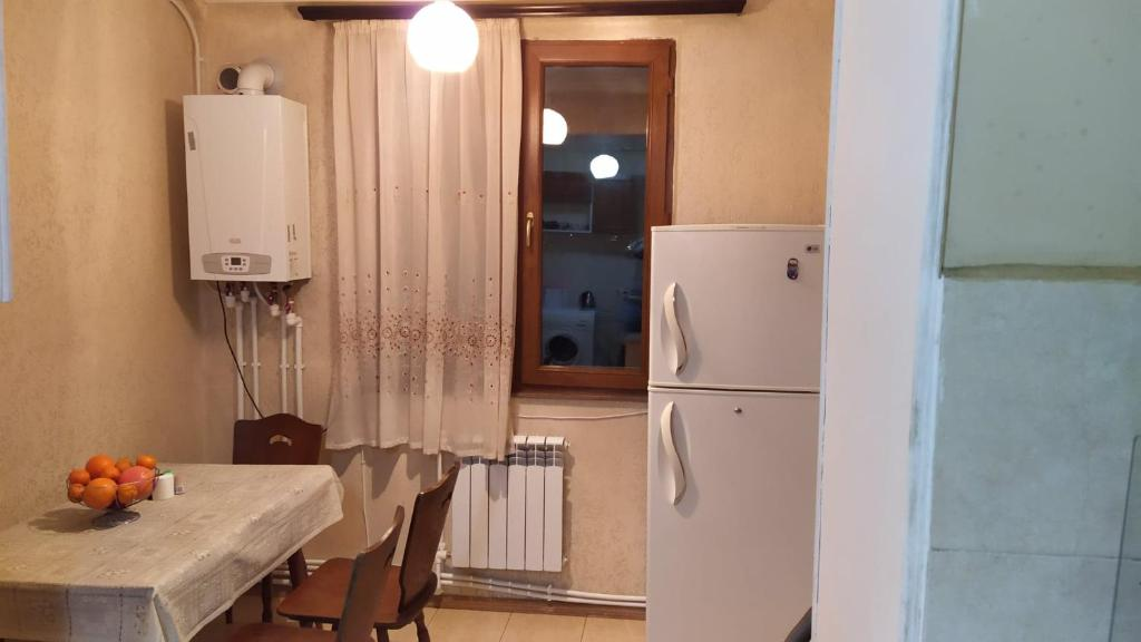 A kitchen or kitchenette at Sara&Aram Apartments
