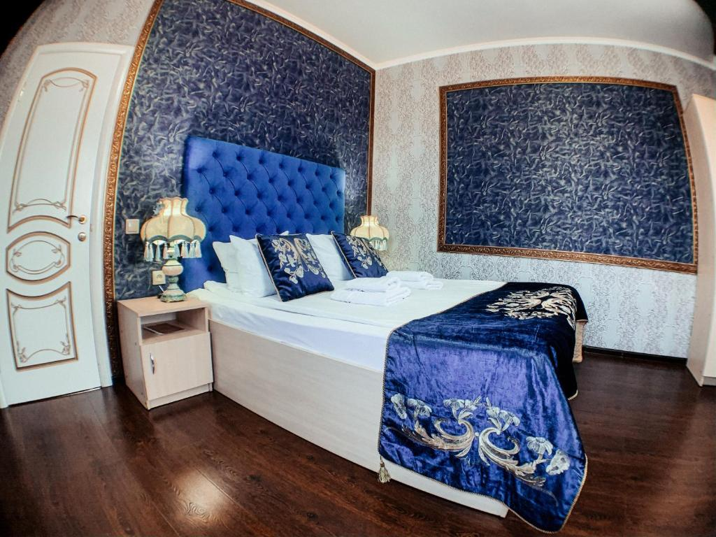 A bed or beds in a room at Sultan in Kislovodsk