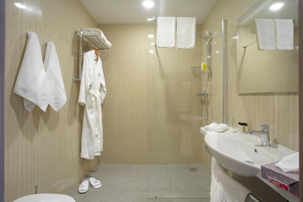 Ванная комната в Hotel Pokrovsky