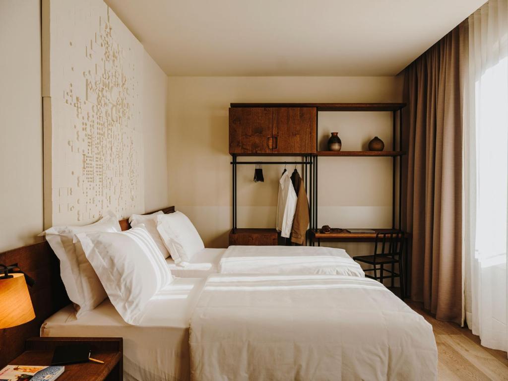 Llit o llits en una habitació de Hotel Casa Luz