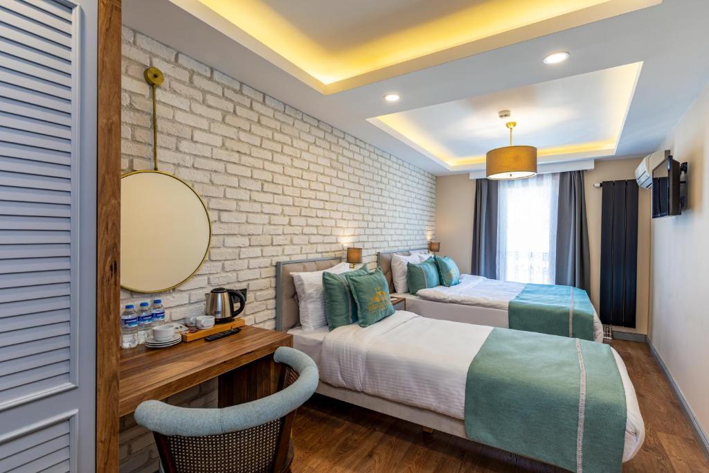 Кровать или кровати в номере İnterstar Hotel