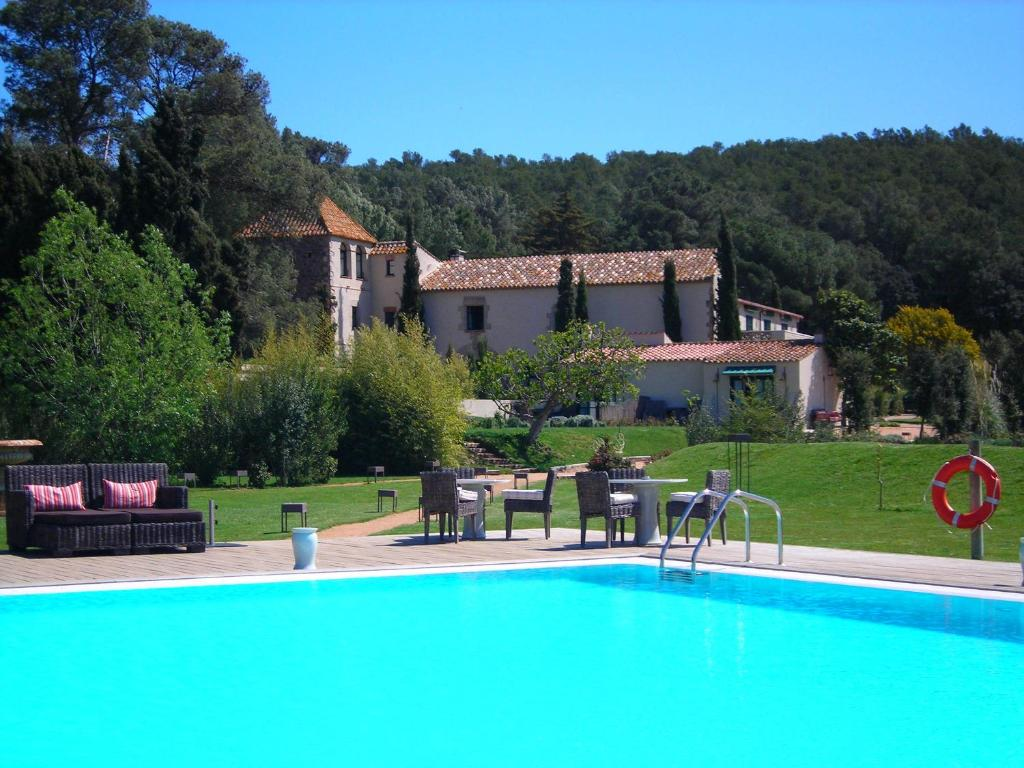 The swimming pool at or near Hotel La Malcontenta