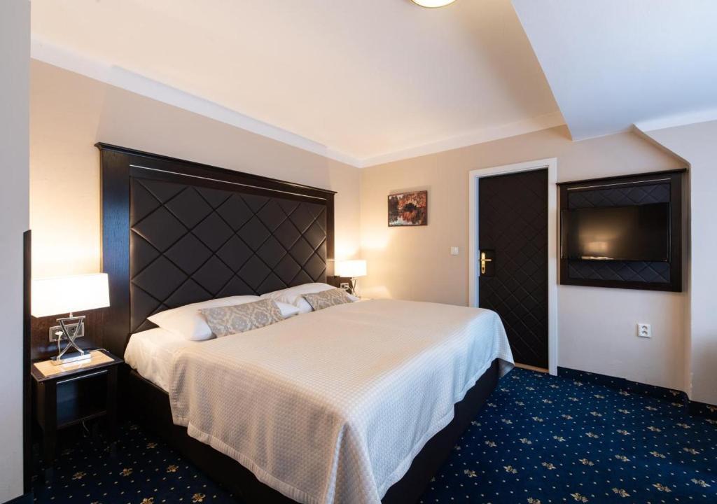 Кровать или кровати в номере Hotel Kampa