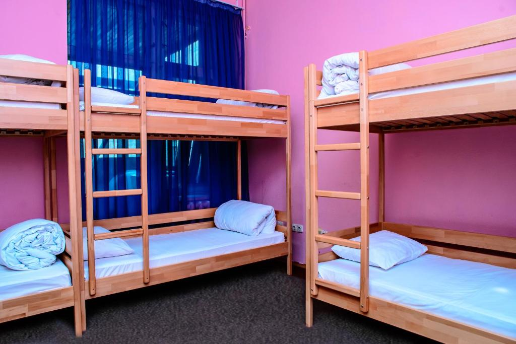 A bunk bed or bunk beds in a room at Compass Kiev Hostel