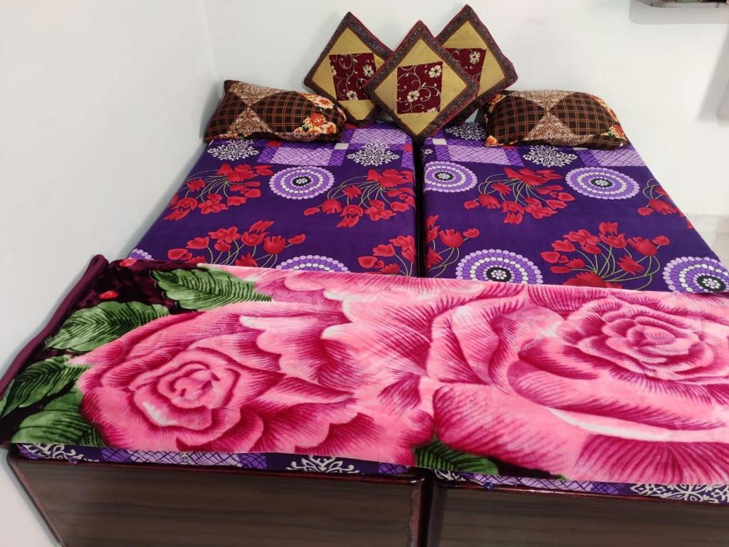 A bed or beds in a room at Nidhivan Aasharm