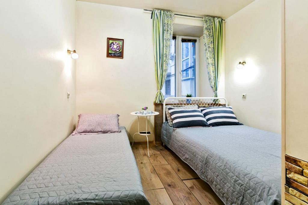 Кровать или кровати в номере Мини-отель Соня на Красных воротах