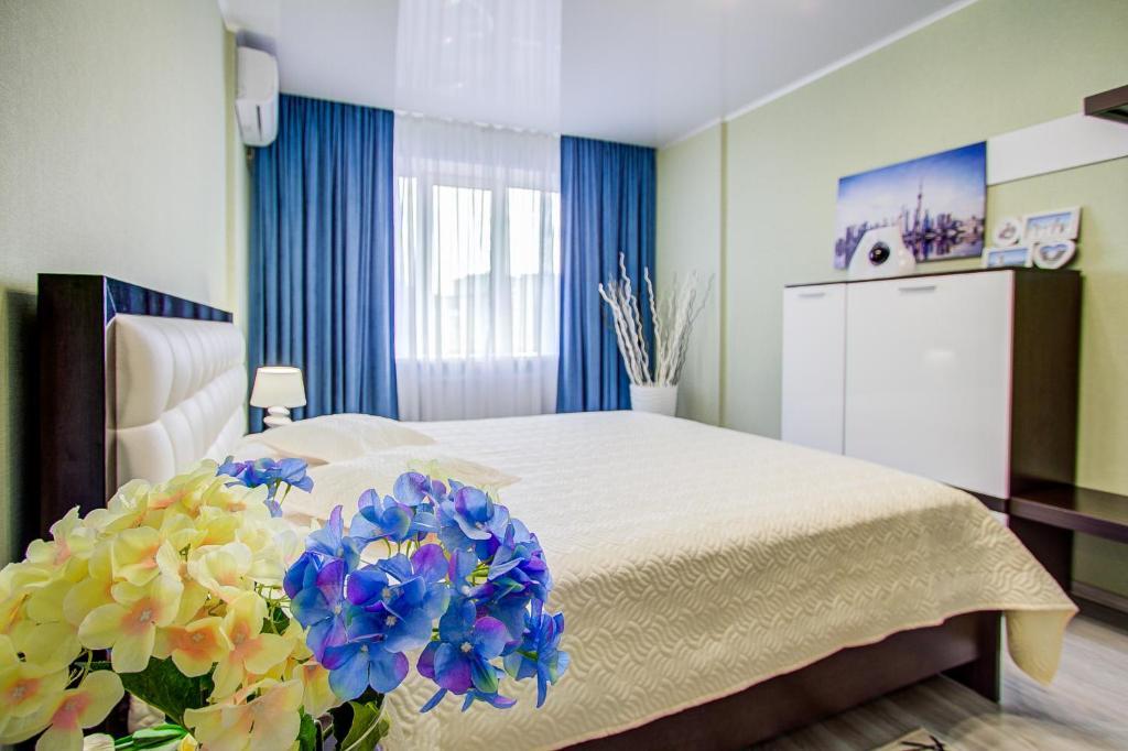 Кровать или кровати в номере Шикарная квартира бизнес-класса