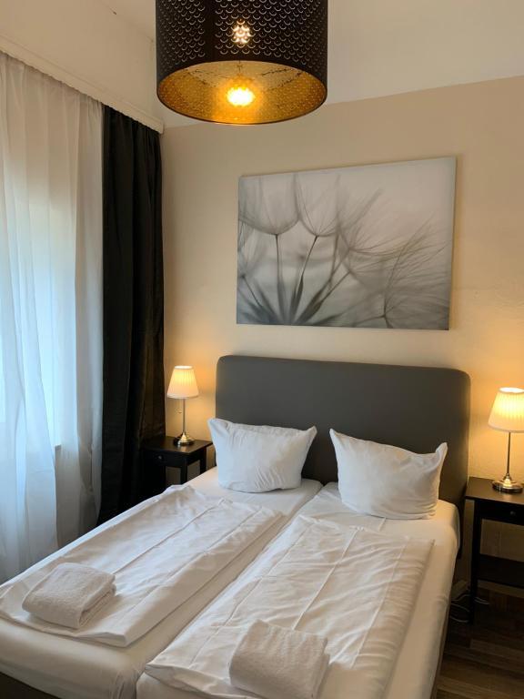 Ein Bett oder Betten in einem Zimmer der Unterkunft Hotel Bee Fang