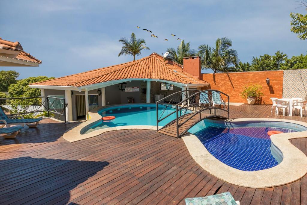 A piscina localizada em Hotel Paraíso das Águas ou nos arredores