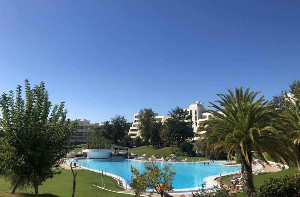 A view of the pool at Akisol Alvor Sun or nearby