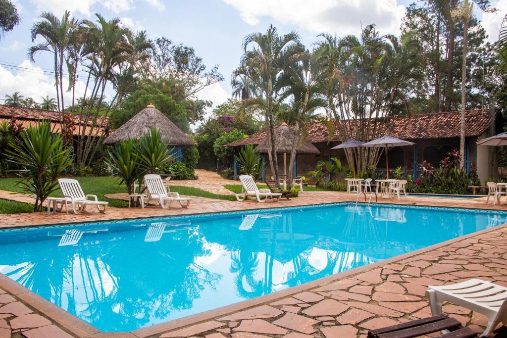 The swimming pool at or near Pousada Villa da Serra