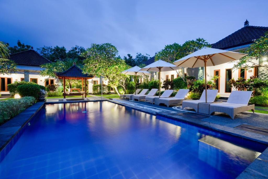 The swimming pool at or near WIRA Homestay & Spa