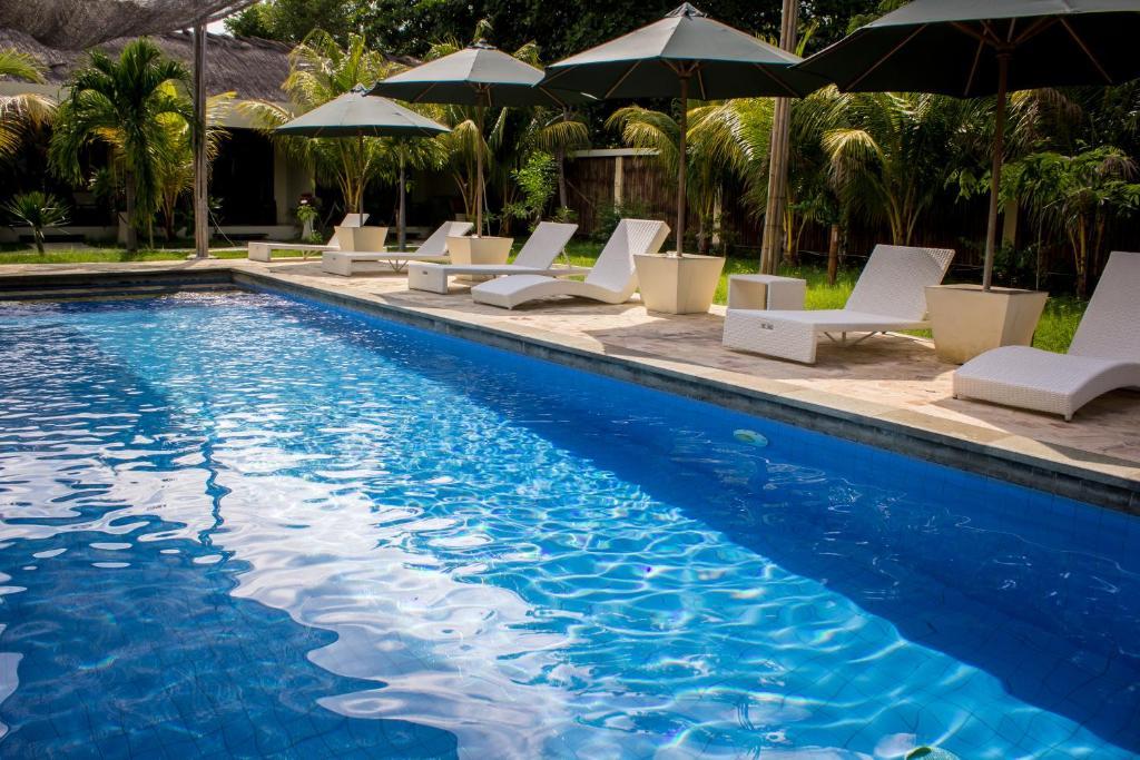 The swimming pool at or close to Kaluku Gili Resort