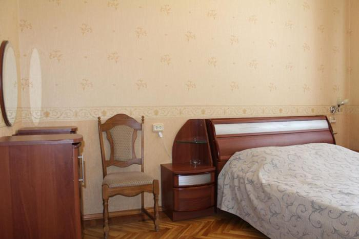 A bed or beds in a room at Lesnaya Dacha