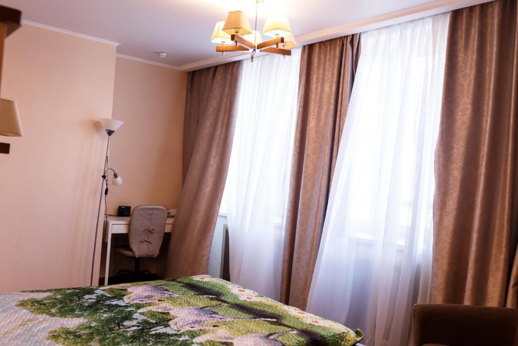 Кровать или кровати в номере Апартаменты - студия в центре Казани - В Гостях как Дома