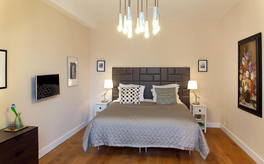 Een bed of bedden in een kamer bij Blue Tulip Amsterdam
