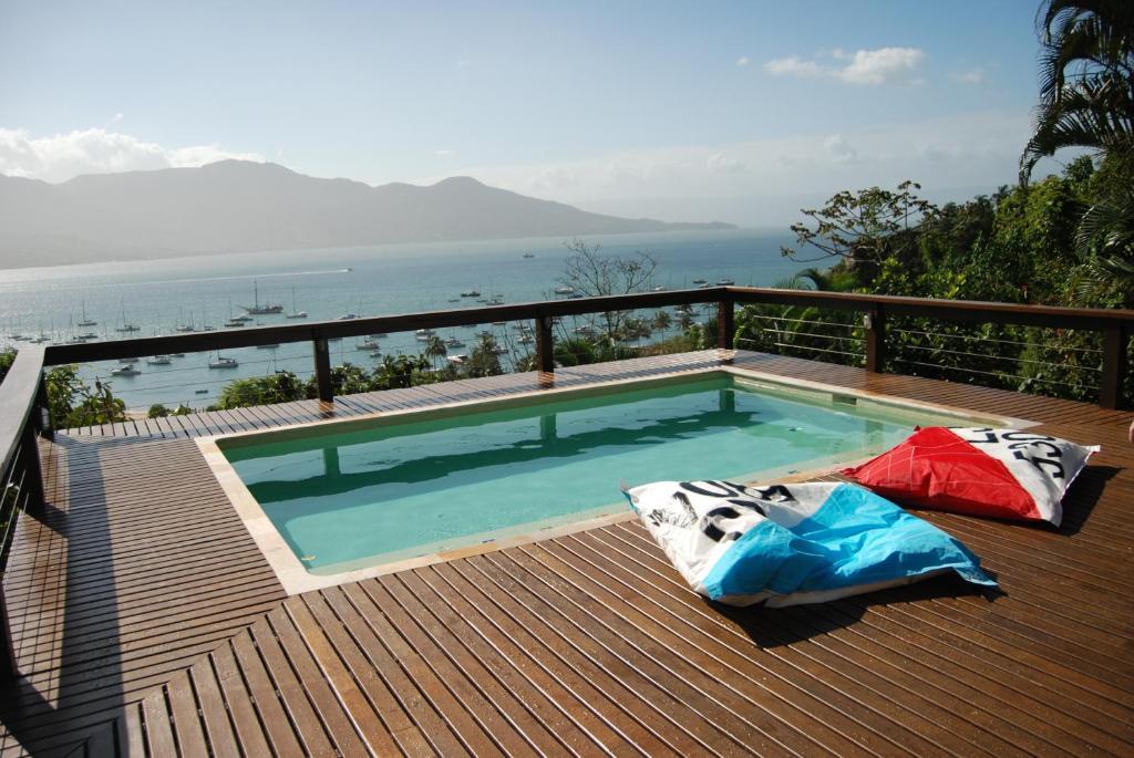 The swimming pool at or near Vila Saco Da Capela Ilhabela