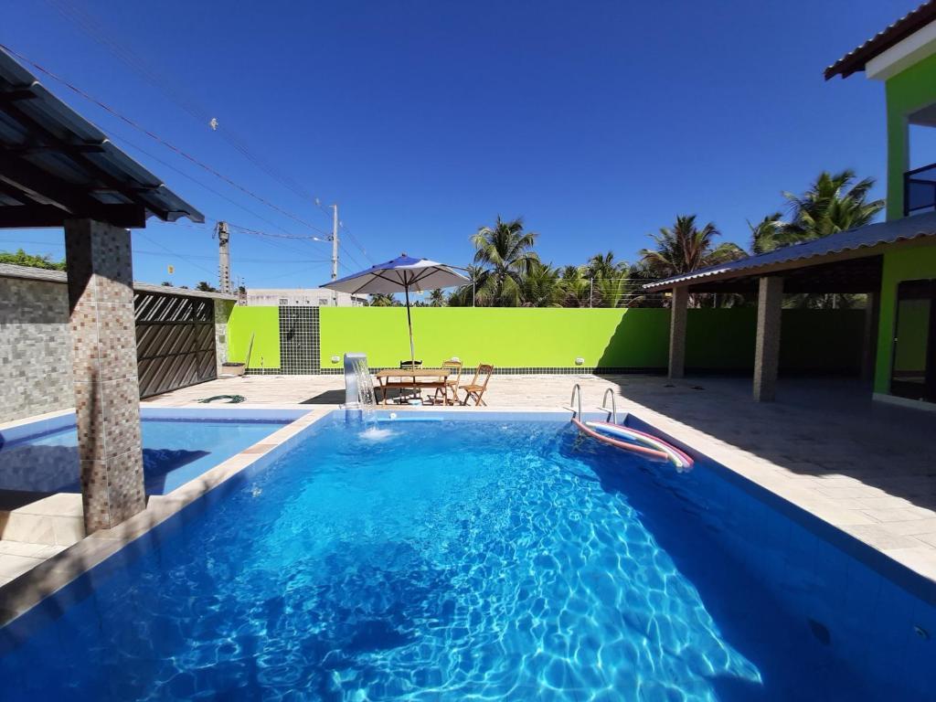 The swimming pool at or close to Beach House Maragogi