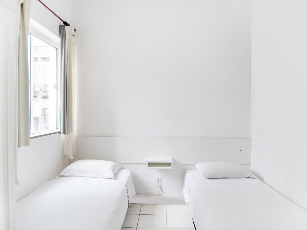 A bed or beds in a room at Guarany da Serra